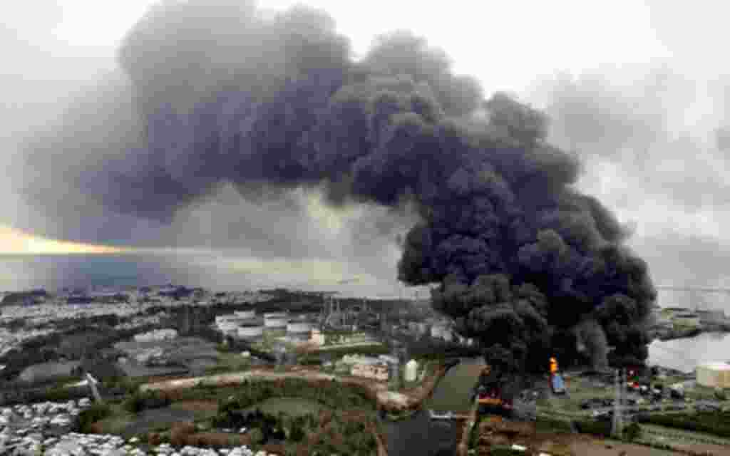 Smoke rises from a burning factory following an earthquake and tsunami in Sendai, northeastern Japan March 12, 2011. Japan confronted devastation along its northeastern coast on Saturday, with fires raging and parts of some cities under water after a mass