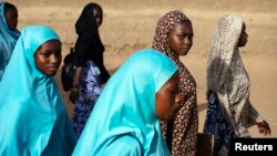 Girls walk to school in Gao, Mali, March 7, 2013.