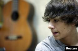 Pedro Gonzalez attends a guitar class at the private music school Escuela de Musica Creativa in central Madrid, Spain, Nov. 6, 2015.
