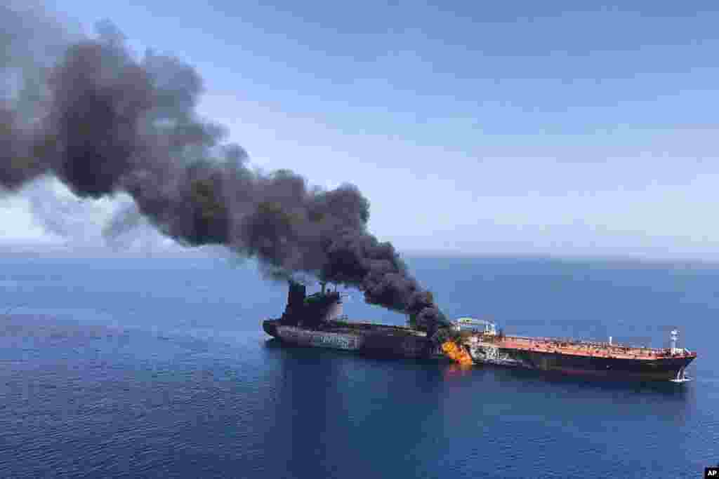 An oil tanker is on fire in the sea of Oman. Two oil tankers near the strategic Strait of Hormuz were reportedly attacked, an assault that left one ablaze and adrift as sailors were evacuated from both vessels.