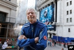 Sir Richard Branson, founder of Virgin Galactic, poses for a photo outside the New York Stock Exchange before his company's IPO, Monday, Oct. 28, 2019. (AP Photo/Richard Drew)