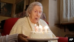 Emma Morano, 117 years old, blows out the candles on her birthday cake in Verbania, Italy, Nov. 29, 2016.