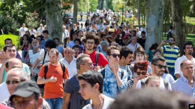 People walk inside Gezi Park at Taksim Square in Istanbul, Turkey, July 8, 2013.