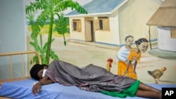 A newly-diagnosed HIV positive woman in the treatment ward of the Mildmay, Uganda clinic, Feb. 27, 2014.