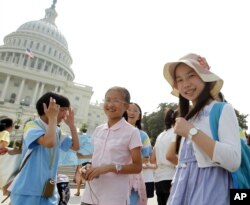 FILE - Chinese students from Hangzhou visit the U.S. Capitol in Washington, July 24, 2011.