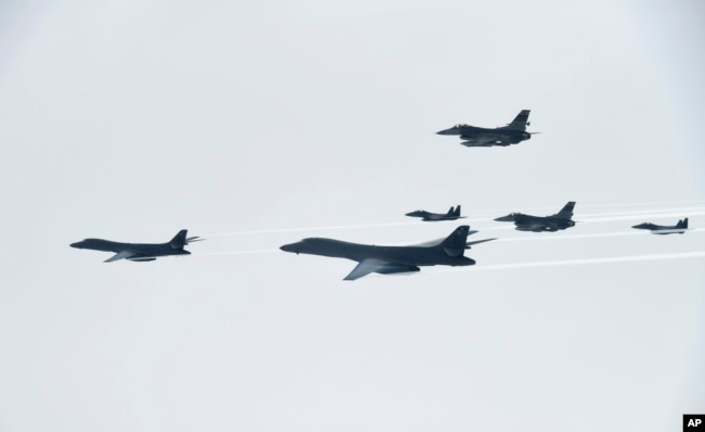 FILE - U.S. Air Force B-1B Lancer bombers, left and second from left, fly with South Korean and U.S. fighter jets over the Korean Peninsula, South Korea, July 8, 2017, in this photo provided by South Korea Defense Ministry.