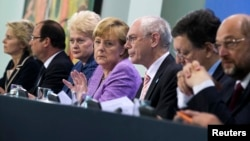 German Chancellor Angela Merkel (4th L), France's President Francois Hollande (2nd L), Lithuania's President Dalia Grybauskaite (3rd L), European Commission President Jose Manuel Barroso (2nd R), European Parliament President Martin Schulz (R), European Council President Herman Van Rompuy (3rd R) and German Labour Minister Ursula von der Leyen attend a news conference after an EU conference on Youth Unemployment in Berlin, July 3, 2013.