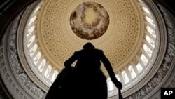 FILE - A statue of George Washington stands in U.S. Capitol Rotunda in Washington.