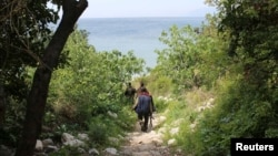 FILE - Islamist fighters are seen in Latakia province, Syria, not far from the Turkish border, March 31, 2014.