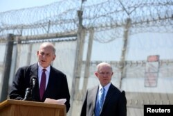 Secretary of Homeland Security John Kelly speaks as Attorney General Jeff Sessions listens as they brief the media during visit to the U.S. Mexico border fence in San Diego, California, U.S. April 21, 2017.