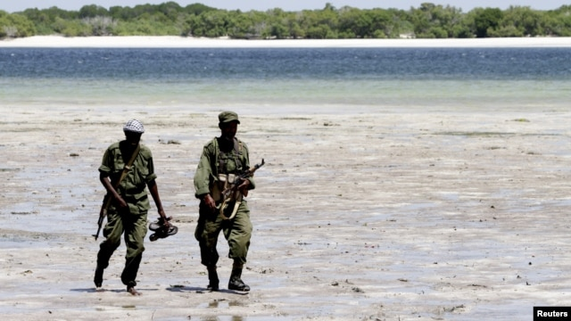 Somalia's Transitional Federal Government (TFG) soldiers patrol the Indian Ocean coastline in Burgabo, south of Kismayu in Somalia, December 14, 2011