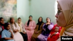 A counselor talks to a group of women to try to convince them that they should not have female genital mutilation performed on their daughters, in Minia, Egypt, Jun. 2006.