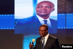 FILE - Emmanuel Ramazani Shadary, Congolese Presidential candidate for the ruling Common Front of Congo (FCC) coalition, announces his political manifesto in Kinshasa, Democratic Republic of Congo, Nov. 19, 2018.