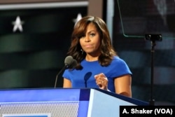 First Lady Michelle Obama spoke of the importance of those in the White House serving as role models to the nation's children at the Democratic National Convention in Philadelphia July 25, 2016 (A. Shaker/VOA)