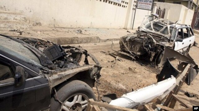 Damaged cars at the site of a bomb explosion in Suleja, Nigeria, February 19, 2012.
