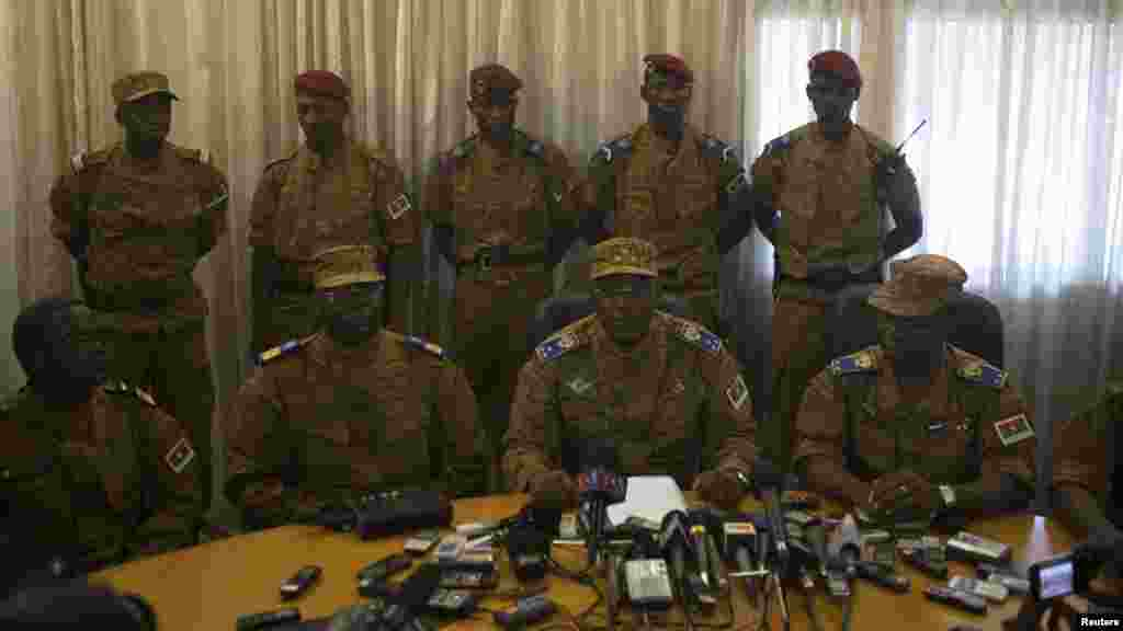 Burkina Faso's military chief General Honore Traore, center, speaks at a news conference announcing his takeover of power at army headquarters in Ouagadougou, capital of Burkina Faso, Oct. 31, 2014.