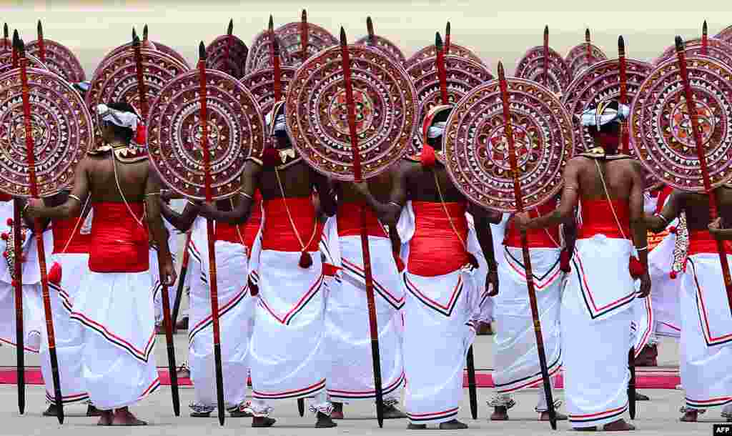Sri Lankan dancers perform a traditional dance during a welcome ceremony following the arrival of Chinese President Xi Jinping at the Bandaranaike International Airport in Katunayake.
