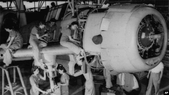 A crew of women work on the final assembly of a bomber in Tennessee on Aug. 31, 1942