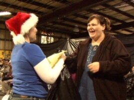 After submitting their holiday requests, families pick up presents and necessities from the Angel Tree warehouse. Tia McCoy asked for basic necessities for her son and daughter.