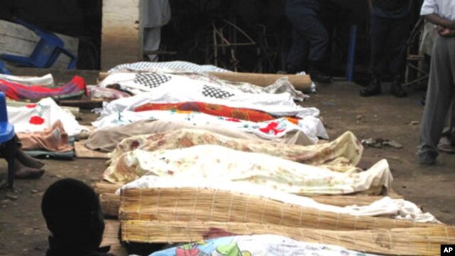 Bodies of victims of armed raiders covered-over with cloth are lined-up for identification on September 19, 2011 in the capital Bujumbura.