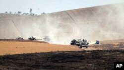 Turkish military move inside Syria near the Turkish border town of Karkamis, Turkey, Aug. 26, 2016. Turkish tanks entered northern Syria on Aug. 24 targeting not only Islamic State fighters but also Kurdish forces.