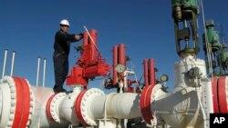 FILE - A worker checks valves on the Yapracik gas pipeline on the outskirts of Ankara, Turkey, Jan. 9, 2009.