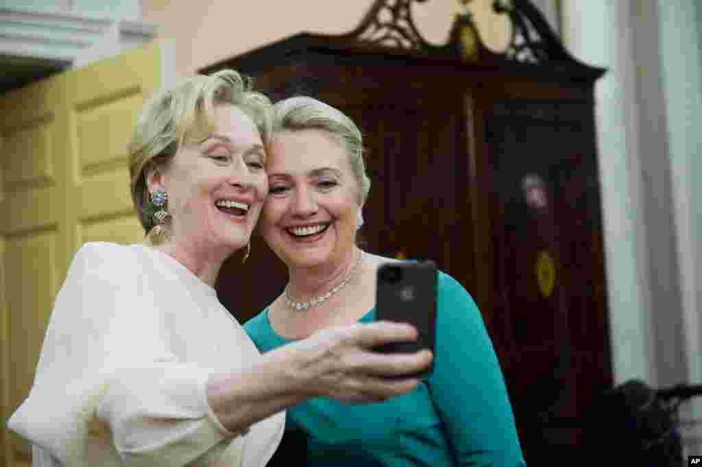 Actress Meryl Streep uses her iPhone to get a photo of her and Secretary of State Hillary Clinton following the State Department Dinner for the Kennedy Center Honors, December 1, 2012.
