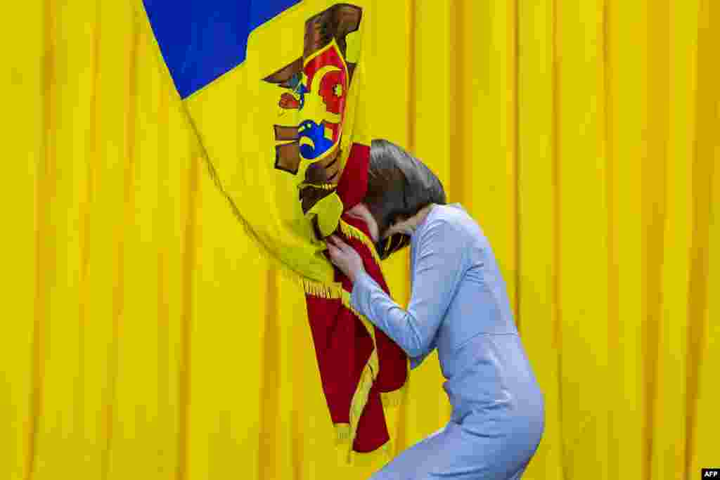 Moldova's President-elect Maia Sandu kisses the national flag during her inauguration ceremony in Chisinau.