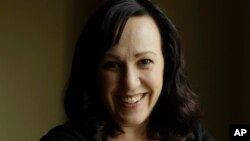 MJ Hegar, shot down in Afghanistan nine years ago, is running for a Texas congressional seat, on Aug. 9, 2018.