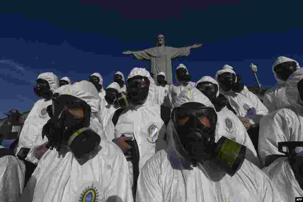 Soldiers of the Brazilian Armed Forces are seen during the disinfection procedures of the Christ The Redeemer statue at the Corcovado mountain prior to the weekend opening of the touristic attraction, in Rio de Janeiro, Brazil.