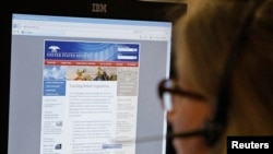 FILE - A journalist checks the U.S. Senate's website after it was attacked by hackers in Washington, June 13, 2011.