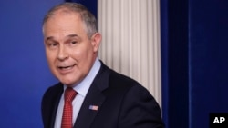 FILE - EPA Administrator Scott Pruitt looks back after speaking to the media during the daily briefing at the White House in Washington, June 2, 2017.