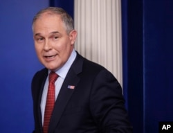 EPA Administrator Scott Pruitt, seen in this June 2, 2017 photo, looks back after speaking to the media during the daily briefing in the Brady Press Briefing Room of the White House in Washington. Records show Pruitt spent weekends in his home state durin