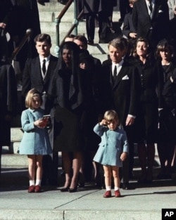Three-year-old John F. Kennedy Jr. salutes his father's casket.