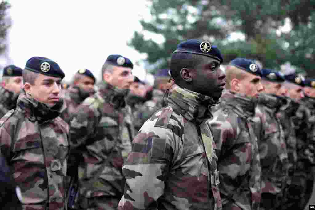 French soldiers line up to listen to a speech by the French Defense Minister Jean Yves Le Drian, at the Satory military camp in Versailles, west of Paris, Jan. 15, 2015.