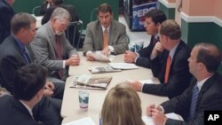 FILE - Lobbyist Brian Ballard, center meets with other lobbyists, from center to left, Mac Stipanovich, Gene McGee Joe McCann, Courtney Bense, Greg Turbeville, Matt Bryan, and Clark Smith in the Capitol cafeteria before the legislative session begins, Apr
