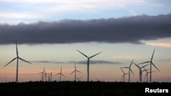 FILE - Iberdrola's power generating wind turbines are seen at dusk at the Moranchon wind farm in central Spain.