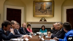 President Barack Obama and Vice President Joe Biden meet with BP executives in the Roosevelt Room of the White House, 16 Jun 2010, to discuss the BP oil spill in the Gulf of Mexico