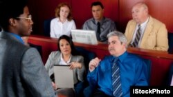 FILE - A new study shows that men become more influential in a jury setting when they display anger while the opposite is true of women.