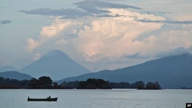 FILE - A boater navigates across Cocibolca Lake, also known as Lake Nicaragua, near Granada, Nicaragua, June 7, 2013.