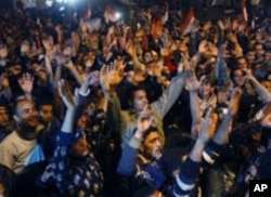 Egyptian citizens celebrate after President Hosni Mubarak resigned and handed power to the military at Tahrir Square, in Cairo, February 11, 2011