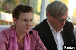 FILE - Renata Lok-Dessallien, left, the U.N. Resident and Humanitarian Coordinator in Myanmar, and British ambassador to Myanmar Andrew Patrick attend a news conference after a trip to the Maungdaw area in northern Rakhine state in Myanmar, Nov. 3, 2016.
