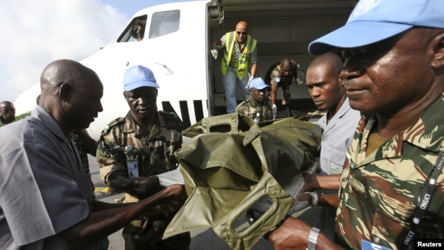 The bodies of the United Nations peacekeepers killed in western Ivory coast near the Liberia border arrive in Abidjan June 9, 2012.