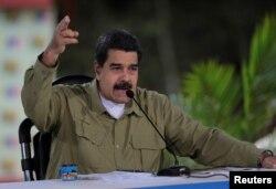 "FILE - Venezuela's President Nicolas Maduro speaks during his weekly broadcast ""Los Domingos con Maduro"" (The Sundays with Maduro) in Caracas, Venezuela, Aug. 6, 2017."