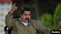 "Venezuela's President Nicolas Maduro speaks during his weekly broadcast ""Los Domingos con Maduro"" (The Sundays with Maduro) in Caracas, Venezuela, Aug. 6, 2017."