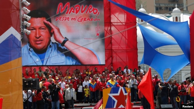 Venezuela's acting President Nicolas Maduro (center) talks to supporters after registering as a candidate for president in the April 14 election outside the national election board in Caracas on March 11, 2013.