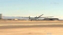 ນັກບິນຂອງກອງທັບສະຫະລັດ ເຝິກແອບ ການນໍາໃຊ້ຍົນ Drone