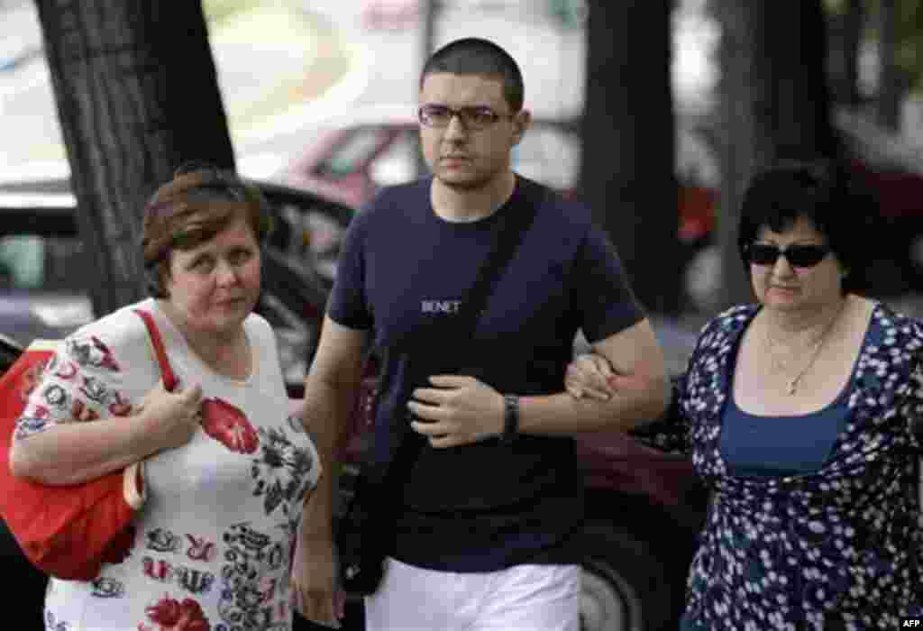 Goran Hadzic's son Srecko Hadzic, center, wife Zivka Hadzic, right and sister Goranka Meseldzija, arrive at the Special Court building in Belgrade, Serbia, Thursday, July 21, 2011. The last Balkan war crimes suspect sought by the U.N. war crimes tribunal