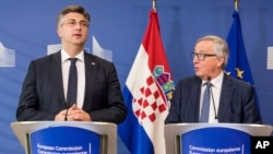 European Commission President Jean-Claude Juncker, right, and Croatian Prime Minister Andrej Plenkovic address the media after a meeting at the EU headquarters in Brussels, Wednesday, Feb. 14, 2018.