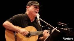 FILE - Cuban musician Silvio Rodriguez performs during a concert in Havana, September 2010.